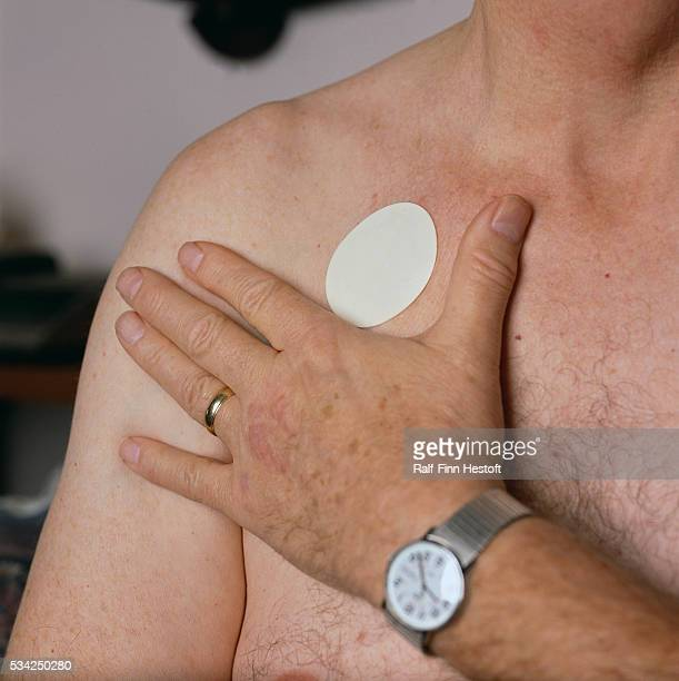 Nicotine Patch on Man's Chest