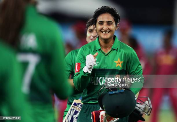 Nida Dar and Bismah Maroof of Pakistan celebrate victory after hitting the winning runs during the ICC Women's T20 Cricket World Cup match between...