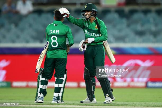 Nida Dar of Pakistan and Bismah Maroof of Pakistan celebrate winning the ICC Women's T20 Cricket World Cup match between the West Indies and Pakistan...