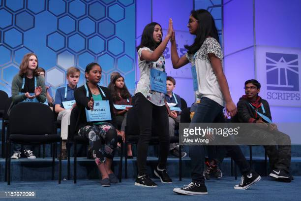 Nidhi Vadlamudi of Santa Clara California highfives Anisha Rao of Dublin California after she misspelled the word kulah during round five of the...
