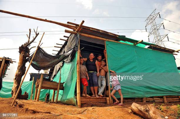 Nidia Yanez displaced by violence poses with her family at her makeshift house at �El Arbol� shantytown southwest of Cali Valle del Cauca departament...