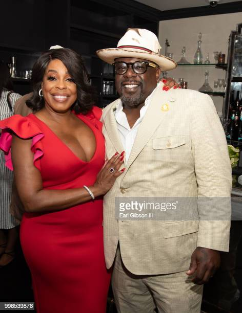 Niecy Nash and Cedric The Entertainer pose for a photo at the afterparty for the celebration of Niecy Nash Star On The Hollywood Walk Of Fame on July...