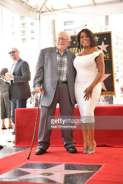 Niecy Nash and Ed Asner pose for a photo as Niecy Nash is honored with a star on the Hollywood Walk Of Fame on July 11 2018 in Hollywood California
