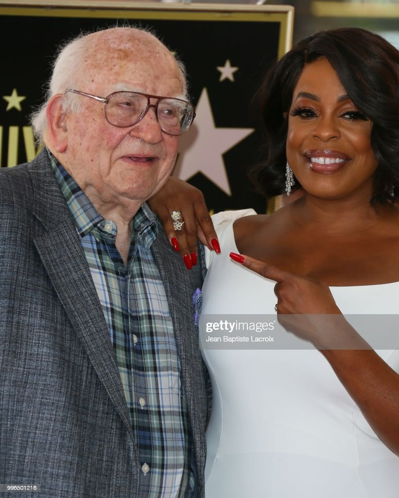 Niecy Nash and Ed Asner pose for a photo as Niecy Nash is honored with a star on the Hollywood Walk Of Fame on July 11, 2018 in Hollywood, California.