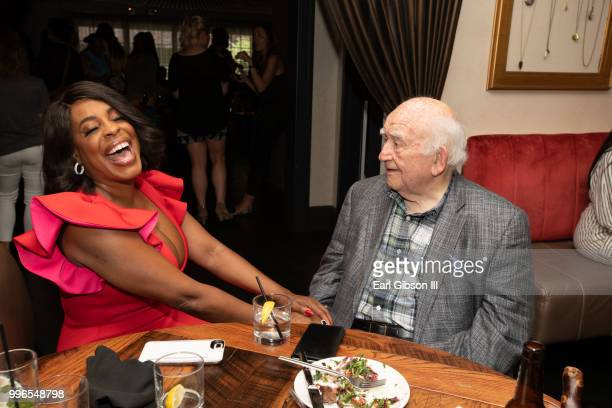 Niecy Nash and Ed Asner share a laugh at the afterparty in honor of her star on the Hollywood Walk Of Fame on July 11 2018 in Hollywood California