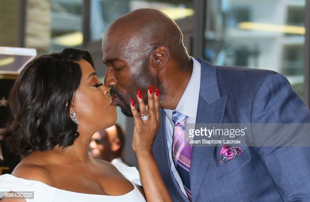 Niecy Nash and Jay Tucker attend a ceremony honoring her with Star on The Hollywood Walk Of Fame on July 11 2018 in Los Angeles California