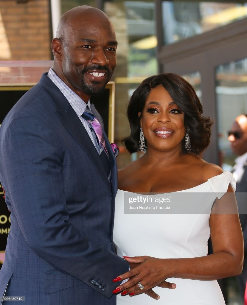 Niecy Nash and Jay Tucker attend a ceremony honoring her with Star on The Hollywood Walk Of Fame on July 11, 2018 in Los Angeles, California.