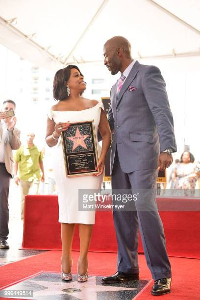 Niecy Nash and Jay Tucker pose for a photo as Niecy Nash is honored with a star on the Hollywood Walk Of Fame on July 11 2018 in Hollywood California