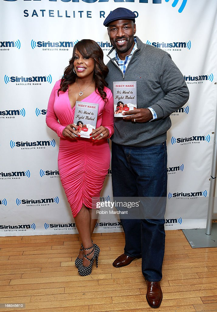 Niecy Nash (L) and Jay Tucker visit at SiriusXM Studios on May 8, 2013 in New York City.