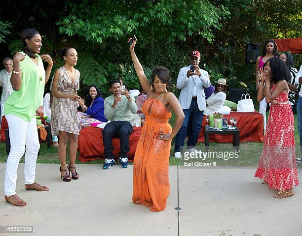 Niecy Nash dances in a Soul Train line at her One Year Wedding Anniversary Celebration on May 27 2012 in Northridge California