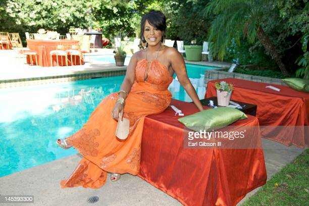 Niecy Nash poses for a photograph in her backyard before guests arrive to celebrate her One Year Anniversary Celebration on May 27 2012 in Northridge...