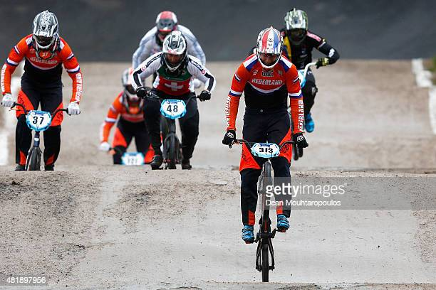 Niek Kimmann of Netherlands celebrates after crossing the finish line first and winning gold in the Men Elite motos during day 5 of the UCI BMX World...