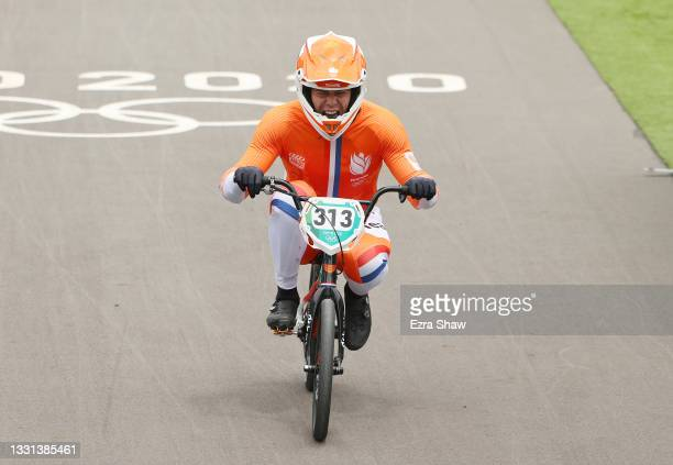 Niek Kimmann of Team Netherlands crosses the finish line as he celebrates winning a gold medal during the Men's BMX final on day seven of the Tokyo...