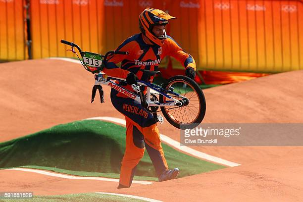 Niek Kimmann of the Netherlands crashes out in the Cycling BMX Men's Quarterfinals on Day 13 of the 2016 Rio Olympic Games at Olympic BMX Centre on...