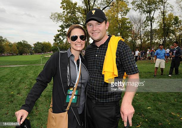 Nieke Coetzee and Branden Grace of the International Team pose for a photo during the Final Round Singles Matches of The Presidents Cup at the...