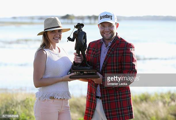 Nieke Coetzee and Branden Grace pose with the trophy after Grace wins the 2016 RBC Heritage at Harbour Town Golf Links on April 17 2016 in Hilton...