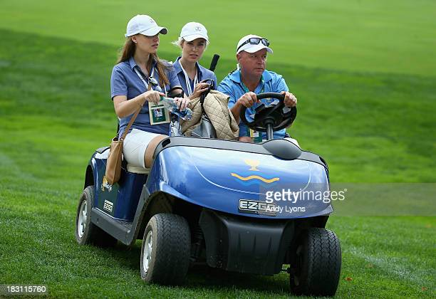Nieke Coetzee LisaMarie Sterne and caddie captain Greg Hearmon watch the action on the 7th hole during the Day Two Foursome Matches at the Muirfield...