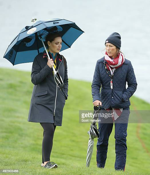 Nieke Coetzee of South Africa and Sybi Kuchar of of the United States wait near the 14th green during the Sunday singles matches at The Presidents...