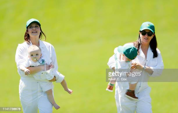 Nieke Coetzee wife of Branden Grace of South Africa holding son Roger walks with Clare Craig wife of Tommy Fleetwood of England holding son Franklin...
