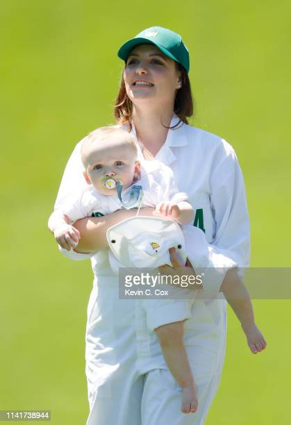Nieke Coetzee wife of Branden Grace of South Africa holding son Roger walks during the Par 3 Contest prior to the Masters at Augusta National Golf...