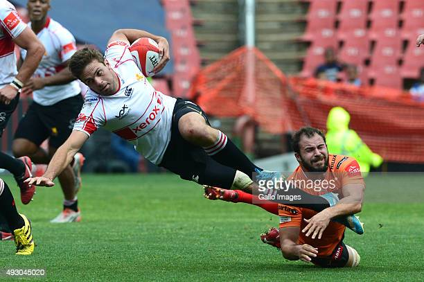 Niel Marris of the Cheetahs tackles Stokkies Hanekom of the Lions during the Absa Currie Cup semi final match between Xerox Golden Lions and Toyota...