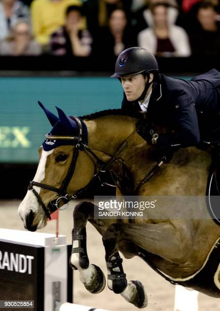 Niels Bruynseels of Belgium riding Gancia de Muze competes in the FEI World Cup Jumping at the Indoor Brabant in Den Boschon March 11 2018 / AFP...