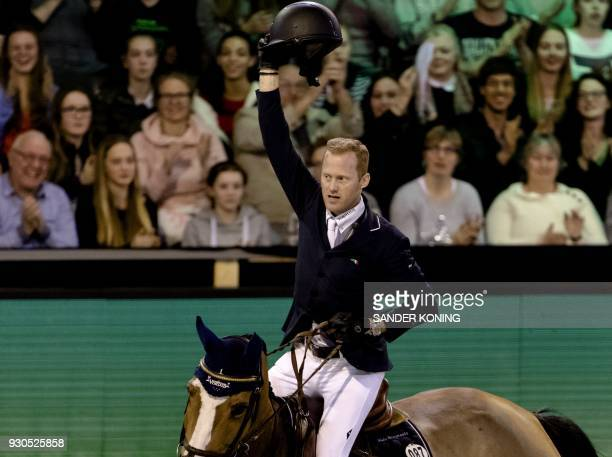 Niels Bruynseels of Belgium riding Gancia de Muze reacts during the FEI World Cup Jumping at the Indoor Brabant in Den Boschon March 11 2018 / AFP...