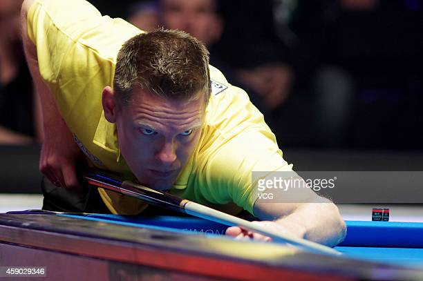 Niels Feijen of Netherlands plays a shot against Daniele Corrieri of Italy on day one of the Partypoker World Pool Masters 2014 at Portland Centre on...