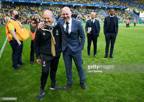 Niels Frederiksen, head coach of Brondby IF with Thomas Gravesen of Discovery after the Danish 3F Superliga match between Brondby IF and FC...