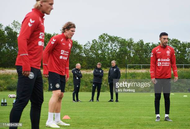 Niels Frederiksen team coach Under21 Jon Dahl Tomasson assistant coach and Age Hareide team coach watching the players during the Denmark training...
