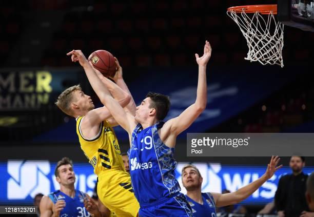 Niels Giffey of Alba Berlin is blocked by Adam Waleskowski of Fraport Skyliners during the EasyCredit Basketball Bundesliga match between Fraport...