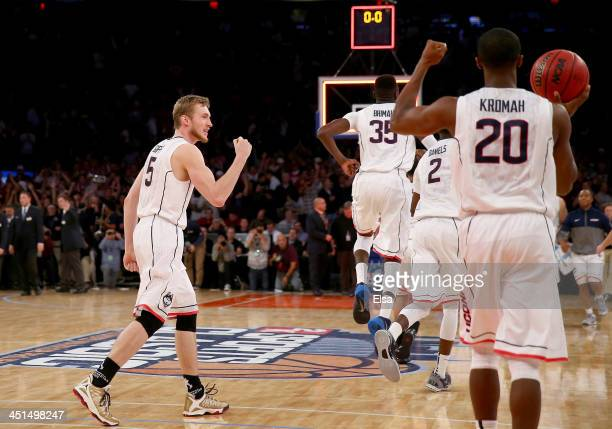 Niels Giffey of the Connecticut Huskies and the rest of his teammates celebrate the win over the Indiana Hoosiers during the 2K Sports Classic at...