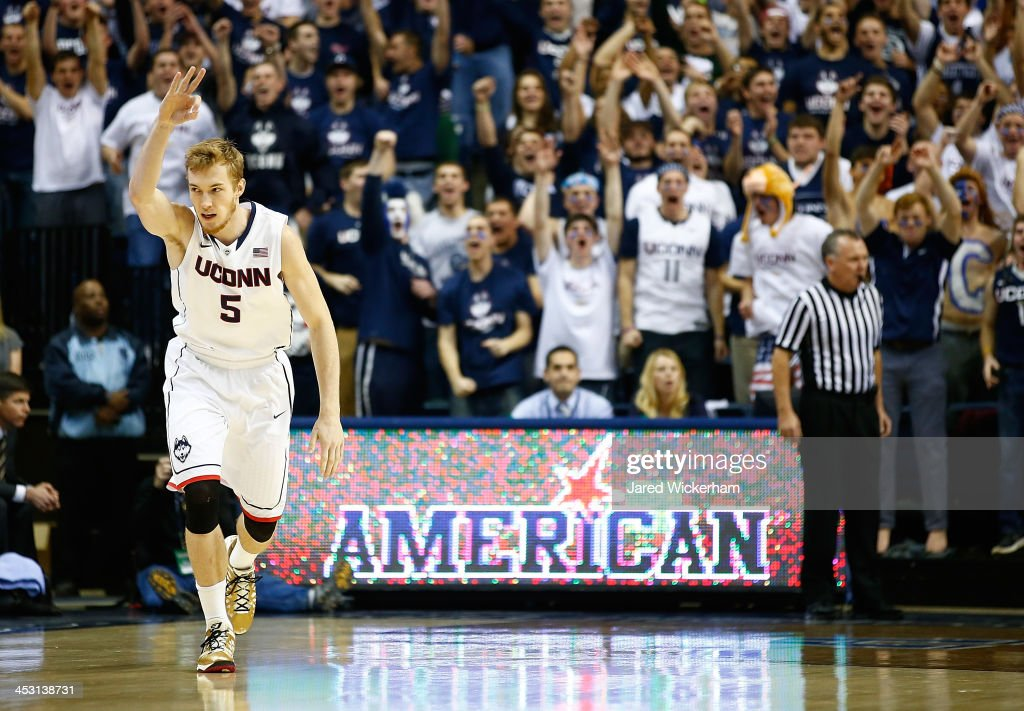 Niels Giffey #5 of the Connecticut Huskies celebrates following a three-point shot against the Florida Gators in the first half during the game at Harry A. Gampel Pavilion on December 2, 2013 in Storrs, Connecticut.