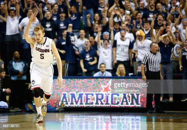 Niels Giffey of the Connecticut Huskies celebrates following a threepoint shot against the Florida Gators in the first half during the game at Harry...
