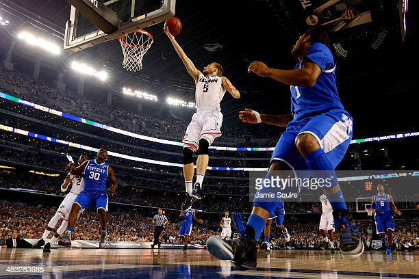 Niels Giffey of the Connecticut Huskies goes up for a basket as James Young of the Kentucky Wildcats defends during the NCAA Men's Final Four...