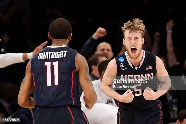 Niels Giffey of the Connecticut Huskies reacts after hitting a basket as Ryan Boatright looks on against Iowa State Cyclones during the regional...