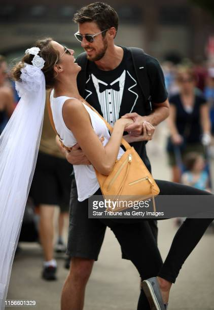 Niels Haenebalcke 34, dipped his newlywed bride Kirsa 28, Haenebalcke as they walked though the crowds at the Minnesota State Fairgrounds Sunday...