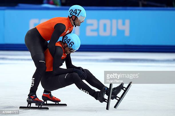 Niels Kerstholt of the Netherlands consoles teammate Daan Breeuwsma after in the Short Track Men's 5000m Relay on day fourteen of the 2014 Sochi...