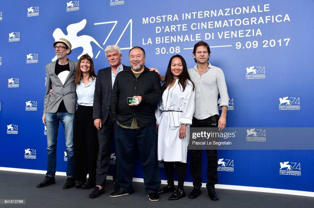 Niels Pagh Andersen, Diane Weyermann, Christopher Doyle, Ai Weiwei and guests attend the 'Human Flow' photocall during the 74th Venice Film Festival on September 1, 2017 in Venice, Italy.