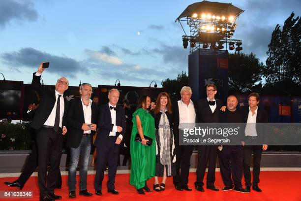 Niels Pagh Andersen Diane Weyermann Christopher Doyle Ai Weiwei and guests walk the red carpet ahead of the 'Human Flow' screening during the 74th...