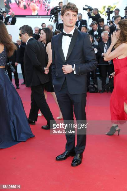 Niels Schneider attends the Ismael's Ghosts screening and Opening Gala during the 70th annual Cannes Film Festival at Palais des Festivals on May 17...