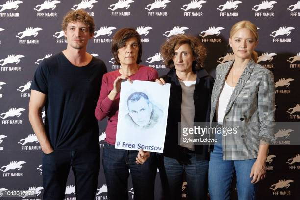 Niels Schneider Catherine Corsini Elisabeth Perez Virginie Efira hold a photo of the Ukrainian filmmaker Oleg Gennadyevich Sentsov to support the...