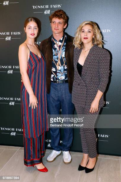 Niels Schneider standng between MarieAnge Casta and Alysson Paradis attend the HM Flaship Opening Party as part of Paris Fashion Week on June 19 2018...