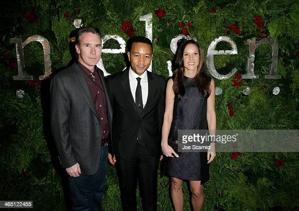 CFO Nielsen Brian West and Sheri West pose with singer/songwriter John Legend at the Nielsen PreGRAMMY Party at Mondrian Los Angeles on January 25...