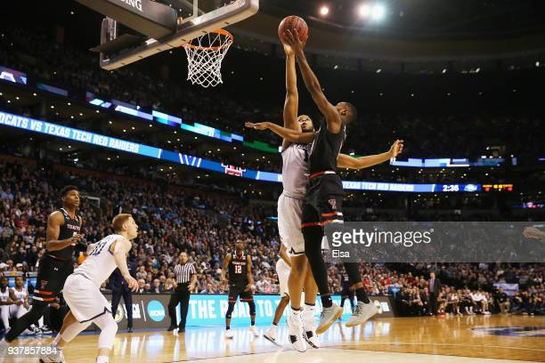 Niem Stevenson of the Texas Tech Red Raiders drives to the basket against Omari Spellman of the Villanova Wildcats during the first half in the 2018...