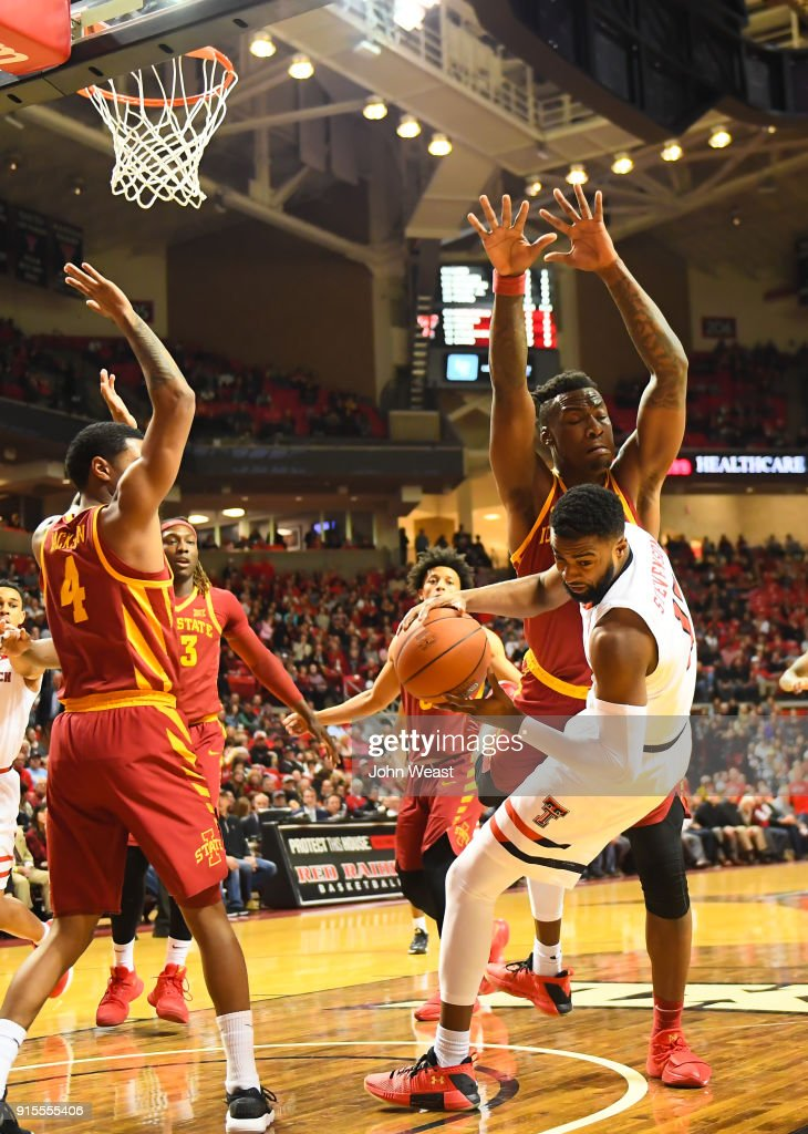 Niem Stevenson #10 of the Texas Tech Red Raiders is fouled by Cameron Lard #2 of the Iowa State Cyclones during the first half of the game on February 7, 2018 at United Supermarket Arena in Lubbock, Texas.