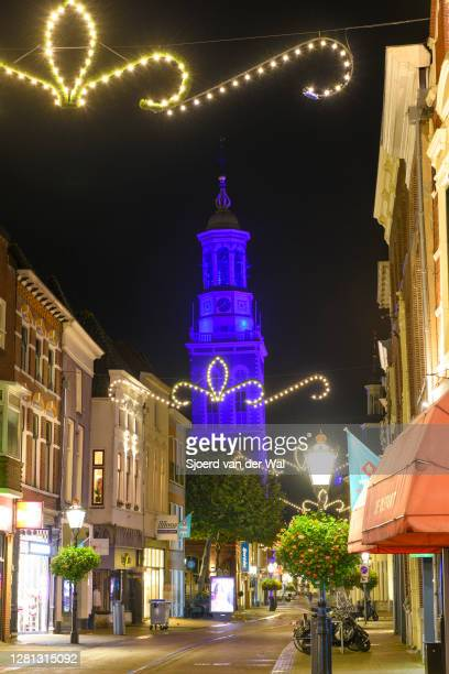 Nieuwe Toren illuminated blue at night to commemorate the 75th anniversary of the United Nations in Kampen Overijssel The Netherlands on October 20...