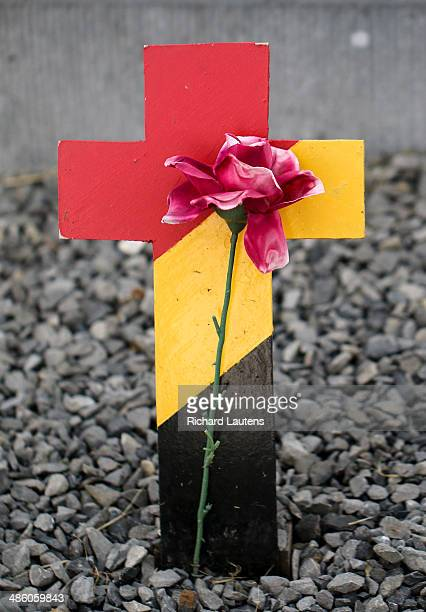 Nieuwpoort Belgium April 20 A flower rests in front of a cross painted with the Belgian flag in front of a tiny roadside memorial Nieuwpoort is the...