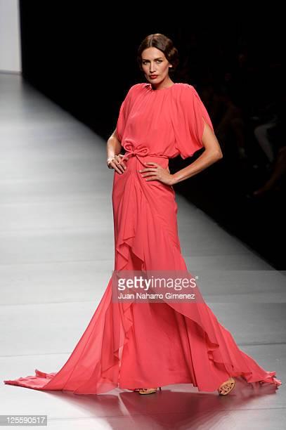 Nieves Alvarez walks the runway in the Juanjo Oliva fashion show during the Cibeles Madrid Fashion Week Spring/Summer 2012 at Ifema at Ifema on...