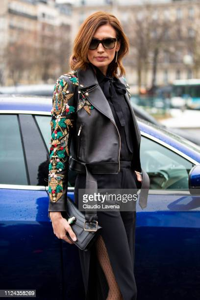 Nieves Alvarez wearing a black shirt black trousers black Bulgari bag and decorated black leather jacket is seen outside Elie Saab show during Paris...